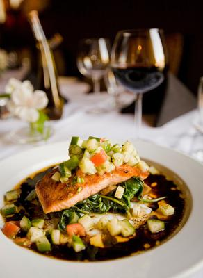 A dish of salmon with red wine